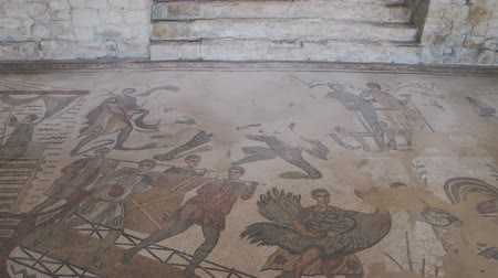 dünya mirası : PIAZZA ARMERINA, ITALY - APRIL, 24: Mosaics of the Roman Villa at the Casale, large and elaborate Roman villa designated as a UNESCO World Heritage Site, famous for the extraordinary collection of frescoes and mosaics on April 24
