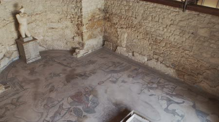 PIAZZA ARMERINA, ITALY - APRIL, 24: Diaeta of Orpheus room in the Roman Villa of the Casale, large and elaborate Roman villa designated as a UNESCO World Heritage Site on April 24