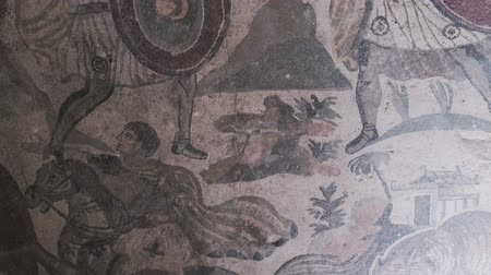 PIAZZA ARMERINA, ITALY - APRIL, 24: Mosaics of the Roman Villa at the Casale, large and elaborate Roman villa designated as a UNESCO World Heritage Site, famous for the extraordinary collection of frescoes and mosaics on April 24