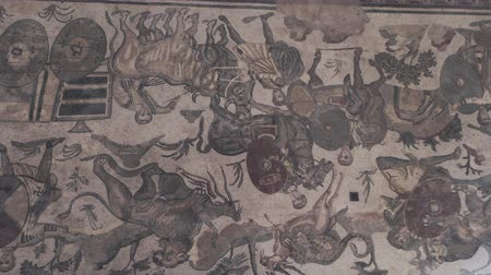 Сицилия : PIAZZA ARMERINA, ITALY - APRIL, 24: Mosaics of the Roman Villa at the Casale, large and elaborate Roman villa designated as a UNESCO World Heritage Site, famous for the extraordinary collection of frescoes and mosaics on April 24