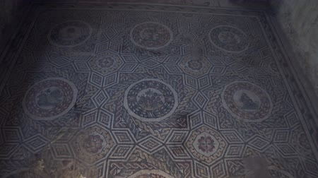 článek : PIAZZA ARMERINA, ITALY - APRIL, 24: Mosaics of the Roman Villa at the Casale, large and elaborate Roman villa designated as a UNESCO World Heritage Site, famous for the extraordinary collection of frescoes and mosaics on April 24