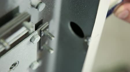 strongbox : The worker installs the locking plug in a safe door. It is removed through refocus. Stock Footage