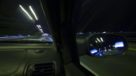 drive : Car driving by night look throu rearview mirror Time lapse