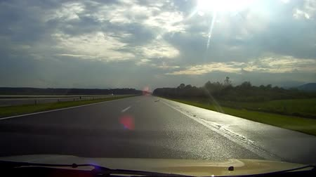 dehet : Car driving on highway cloudy sky