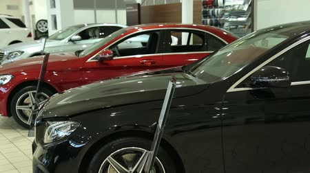 auto show : View of row new car at new car showroom. Brand New Cars in Stock. New Cars Market.