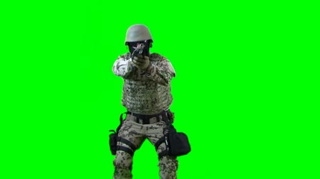 asker : Soldier shoots with gun - seperated on green screen for easy use Stok Video
