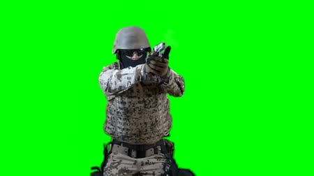 katonák : Soldier shoots with gun - seperated on green screen for easy use Stock mozgókép