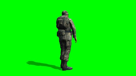 asker : US Soldier looking around - seperated on green screen