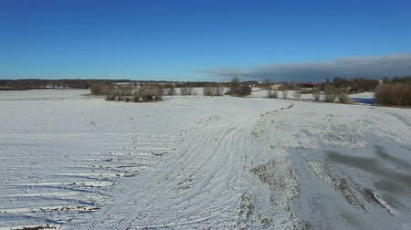 aerial view fly over snowy landscape with blue sky in germany - dronen flight Stock Footage