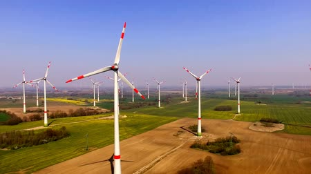 aerial view of a wind turbine - Eco power in a agriculture field Stock Footage