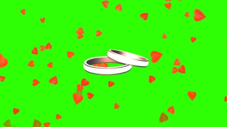 halkalar : rotating wedding rings between falling hearts - green screen