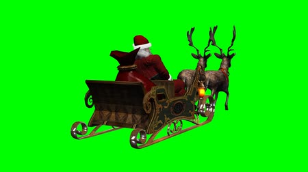 santa : Santa Claus with sleigh and running reindeers - green screen