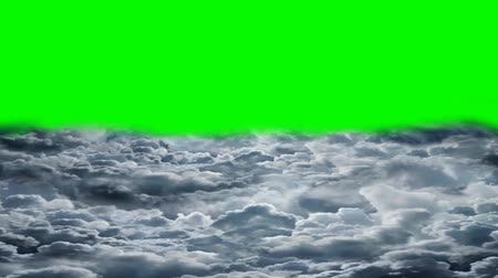 flying over the clouds - green screen Stock mozgókép