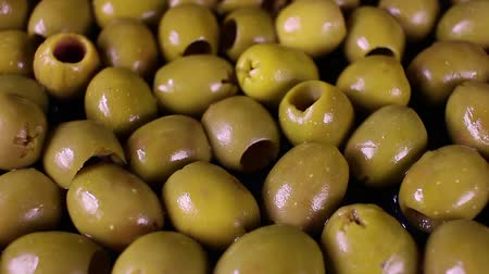 symbol : Olive texture. Olives as background. Shiny green olives. Olive wallpaper pattern texture.