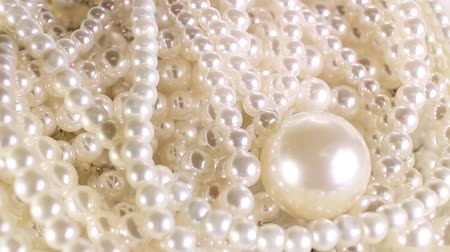 White pearl perarls as background. Jewel,jewelry. Stok Video