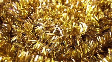 shiny gold Tinsel plastic christmas garland Stok Video