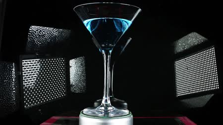 Blue curuacao cocktail on martini glass