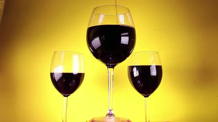 Red wine in glass on colorful background