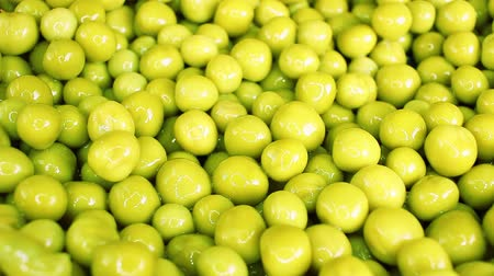 peas : Green pea peas rotating texture pattern closeup footage
