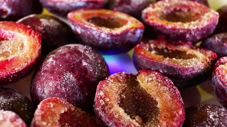 gif : Frosen plum plums purple half fruit rotating texture pattern closeup footage