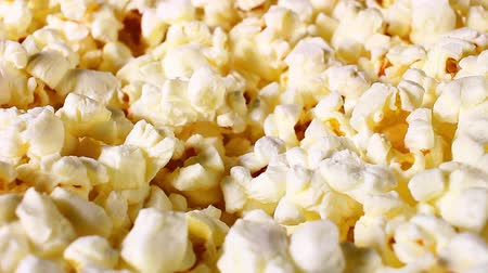 Popcorn popcorns rotating closeup texture pattern background Stock Footage