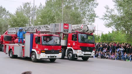 makedonia : Greek Fire Service tracks parade. Greek firefighters in uniform parade on Hellenic Fire Brigade vehicles during during 28 October National Oxi Day parade. Stock Footage