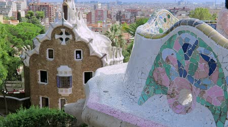 porters : Barcelona, Spain Park Guell Casa del Guarda - Porters Lodge. It houses the exhibition Guell, Gaudi and Barcelona, the expression of an urban ideal. Barcelona city view in background. Stock Footage