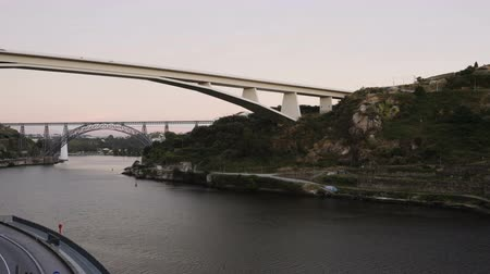 infante : Porto, Portugal 3 bridges over Douro river 4k evening to night time lapse. Infante D. Henrique, Maria Pia and St John bridges with passing clouds above.