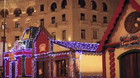 yunan : Thessaloniki, Greece Christmas 2018 decorations at Aristotelous square. Night view of festive installments at the main city square. Stok Video