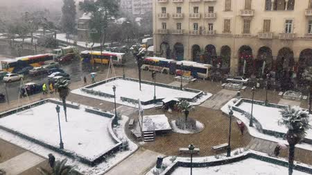 makedonia : Thessaloniki, Greece heavy snowfall at the city center. Snow and traffic at the city main square, Aristotelous.