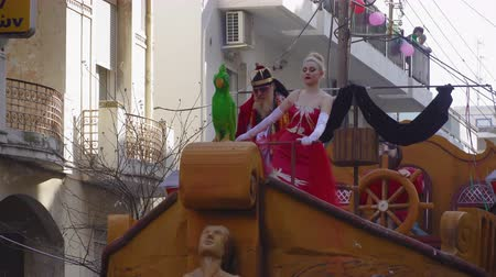 festett : Xanthi, Greece Carnival King and Queen posing. Carnival king dressed as a pirate and Queen on a red dress aboard a parade float.