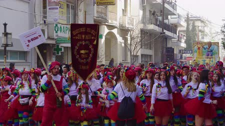 仮面舞踏会 : Carnival parade participants marching in costumes in Xanthi, Greece. Every year teams parade on the streets of Xanthi dressed in various thematic outfits.