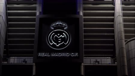 real madrid : Real Santiago Bernabeu Stadium facade with team logo in Madrid, Spain. External night view of 1947 Estadio Santiago Bernabeu home of football team Real Madrid F. C., in the Spanish capital. Stock Footage