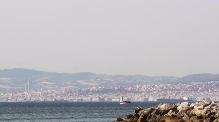 yunan : Thessaloniki Greece daily sea view. Coastal view of city with boat sailing on Thermaic Gulf, seen from nearby town of Neoi Epivates.