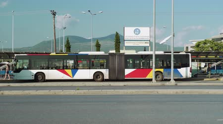 yunan : Thessaloniki, Greece A.S. IKEA terminal of OASTH public transportation city bus. Day view of bus at Thessaloniki Urban Transport Organization station in the city east side.