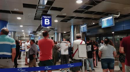 прибытие : Arrival Hall at Thessaloniki, Greece SKG airport. Unidentified people waiting for passengers, standing at arrival area B of Thessaloniki International airport Makedonia.