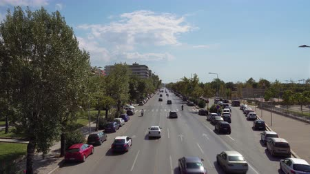 yunan : City road traffic on a multi lanes avenue in Thessaloniki, Greece. Elevated day sunny view of Leoforos Megalou Alexandrou with passing cars.