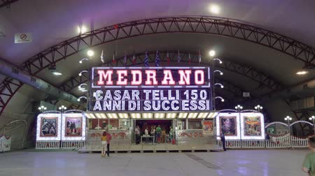 macedonian : Circo Medrano entrance with ticket booth. Illuminated sign of famous Medrano Circus, during 84rth Thessaloniki Greece International Fair.