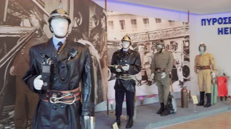 yunan : Greek Fire Service old uniforms on display. Evolution of Hellenic Fire Corps on exhibition firefighter dummies with helmets during 84th Thessaloniki International Fair.