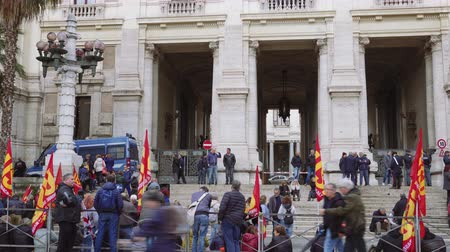 demokratický : Rome, Italy people protest outside Italian government ministry. Large crowd under police presence, quietly protesting outside The Ministry of Education University & Research Ministero dell Istruzione.