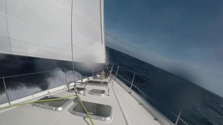 Sailing upwind into some big waves