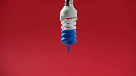 drip bulb : Bulb with blue paint on it Stock Footage