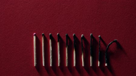 sulfur : Burnt matchsticks on red background