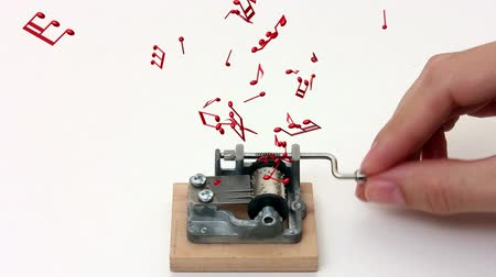 windup : music notes flying out of music box – white background