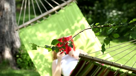 гамак : Woman is reading book in hammock
