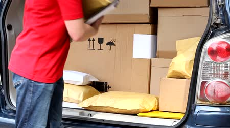 paket : Courier in red uniform at work video