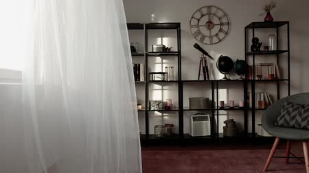 Curtain moving in a modern living room interior. Video
