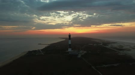 navigasyon : Aerial View of a Lighthouse Close Up on a Easter Sunday SunRise as Seen by a Drone