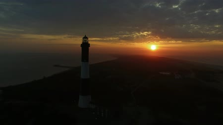 vasárnap : Aerial View of a Lighthouse Close Up on a Easter Sunday SunRise as Seen by a Drone