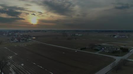 Aerial View of Amish Farm Lands at Sunset on a Stormy  Winter Day as Seen by a Drone